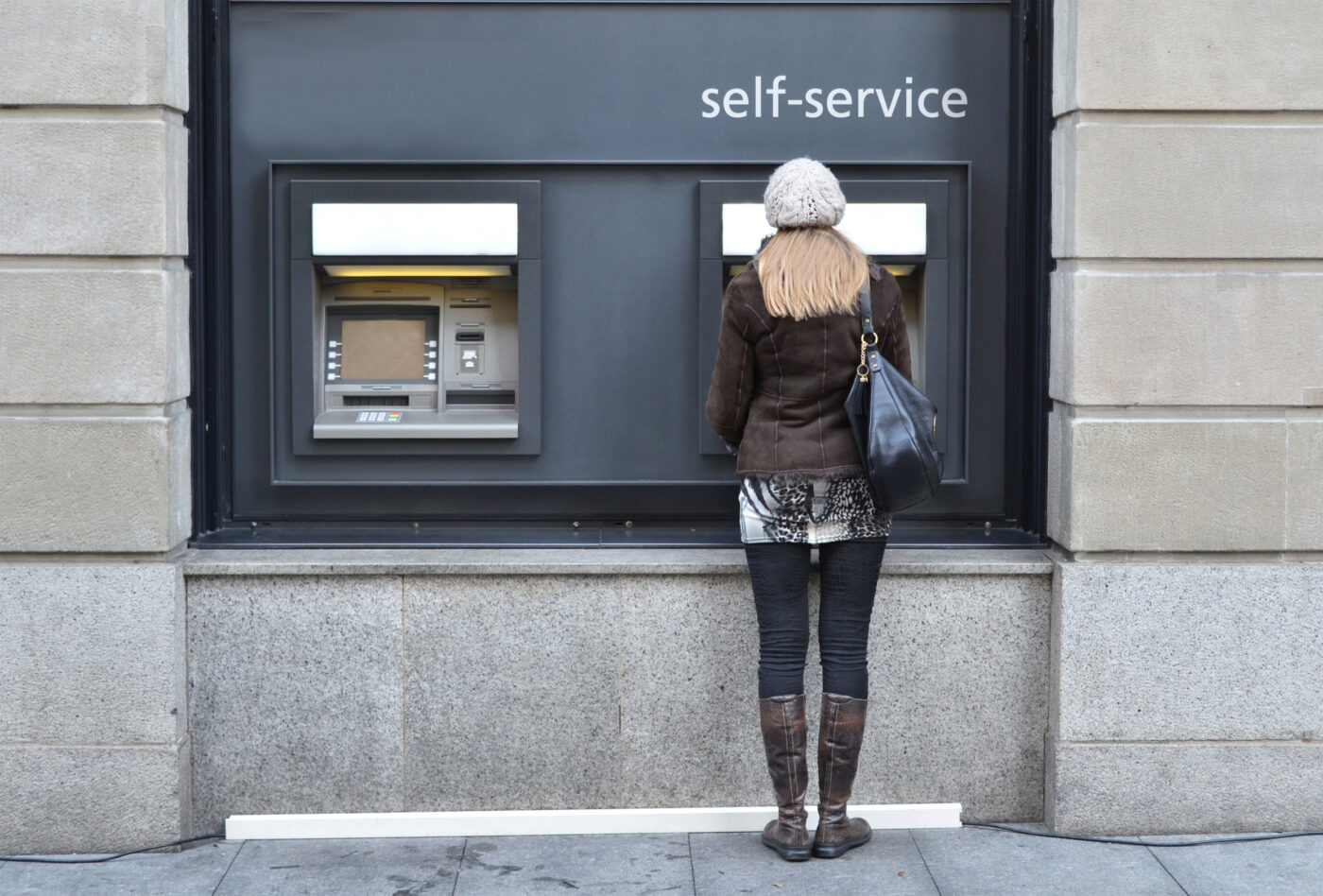 Woman at self service cash point